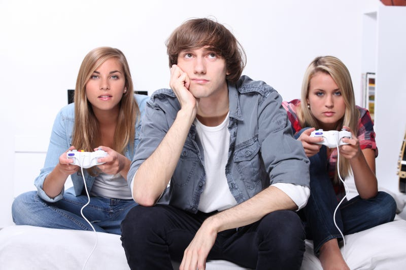 Fake Gamers of the Week: Bored Blonde Teenagers with Mismatched Controllers