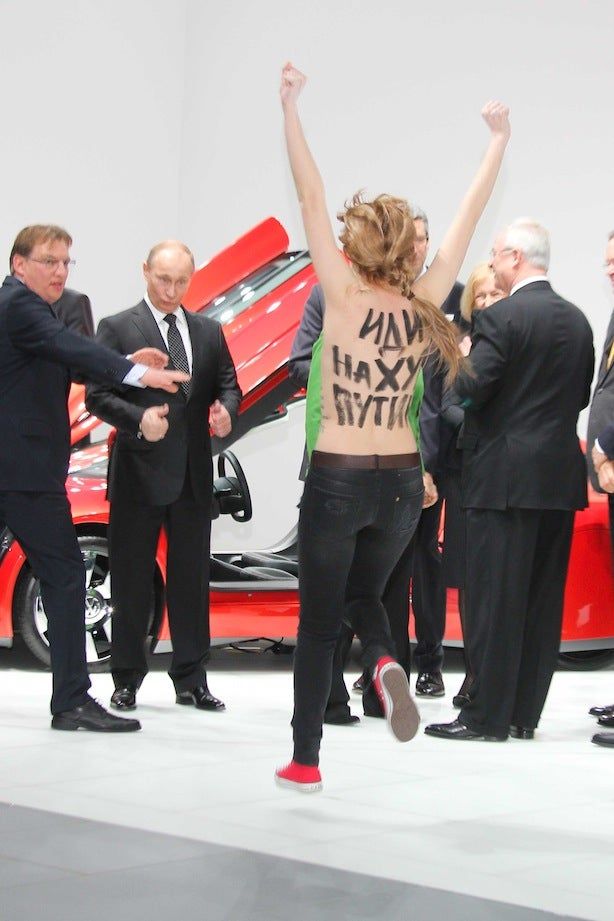Vladimir Putin Was Confronted By A Topless Protestor, And He Really, Really Liked It