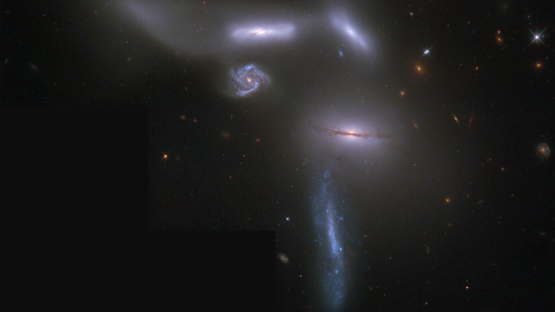 Four galaxies are smashed together in a space the size of the Milky Way