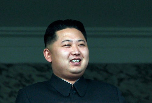North Korea's Kim Jong-un Smiles at Military Parade as Nation Weeps