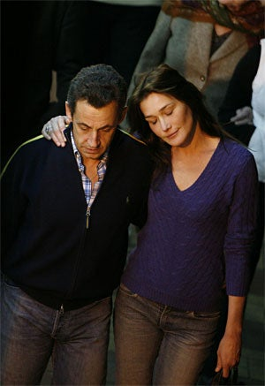 Carla Bruni, French President Nicolas Sarkozy: It's Serious & Sartorial