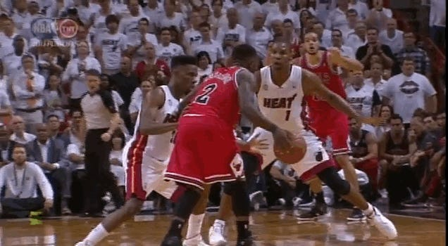 Nate Robinson Dribbles Through Chris Bosh's Legs