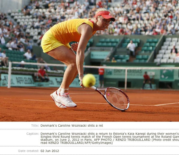 Today In Photograph And Caption Synergy: Caroline Wozniacki Shits A Return