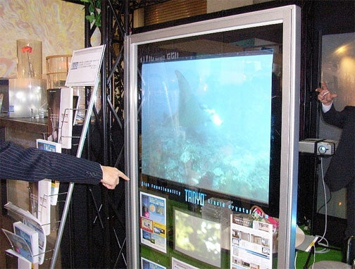 Flexible, Cuttable ViVid Screen Turns Any Window Into an Obnoxious Video Advertising Display
