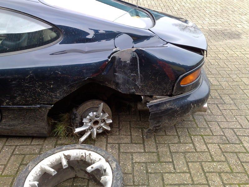 Aston Martin DB7 Wheel Cracks Up In Crash