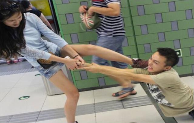 Smartphone Gamer Dragged Through the Subway