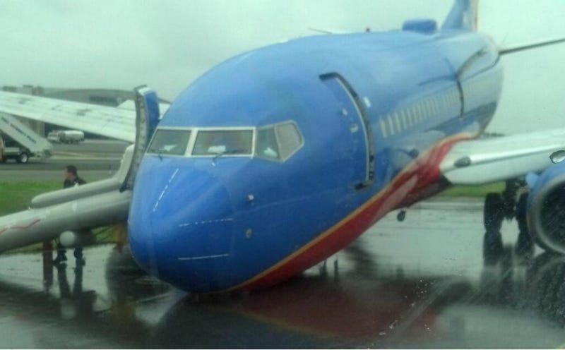 Plane's Nose Gear Collapses While Landing at Laguardia