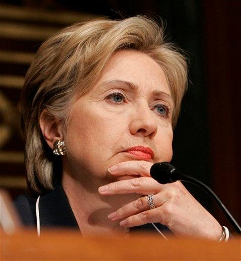 Why The Sad Glare Of Resignation, Hillary? Wait, Wait, Don't Tell Me!