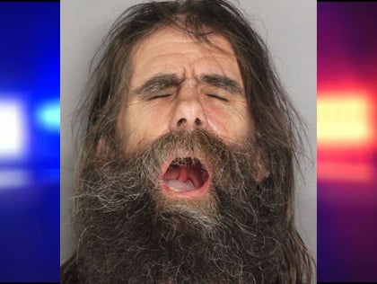 man throws spear at car, does passable Capt. Caveman impersonation