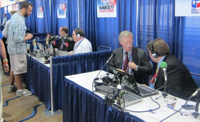 Radio Row Is Like Bizarro High School, and Mike Huckabee is Prom King