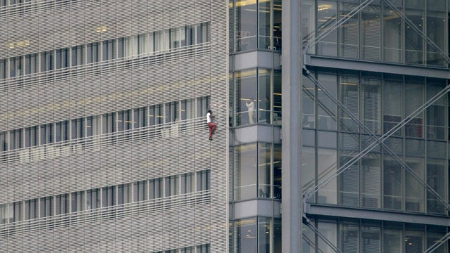 Man Scales the New York Times Tower for a Newspaper