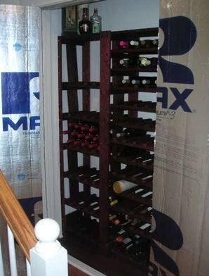Convert your extra closet into a mini wine cellar for Turn closet into wine cellar