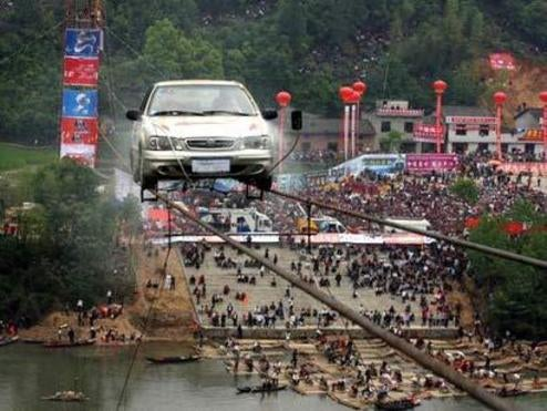 Chinese One-Ups Hippies, Clowns By Tight Rope Driving