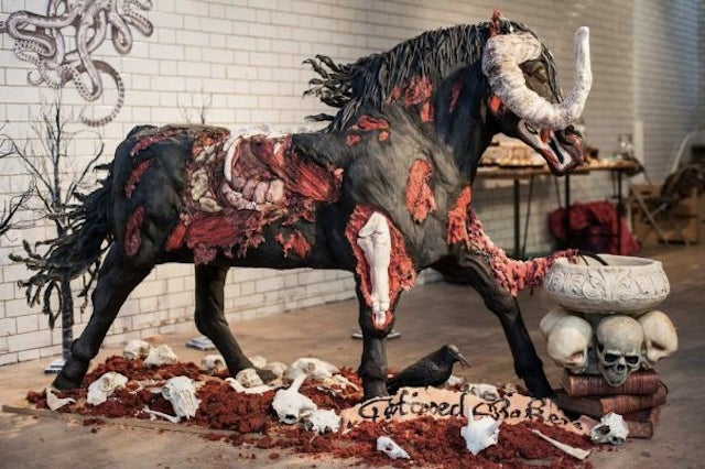 Rum pours from the nostrils of this massive devil horse cake