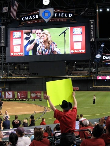 Jessica Simpson Entertains Phoenix Baseball Fans, Car Wreck Aficionados