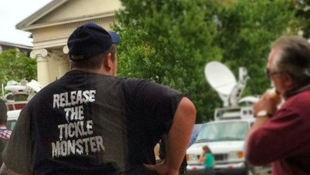 "Someone Is Wearing A ""Release The Tickle Monster"" T-Shirt Outside The Jerry Sandusky Trial"