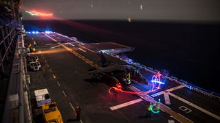 This impressive Marine Corps light show is almost as good as any frame from the movie Tron. What you see is actually an AV-8B Harrier preparing to take off aboard the USS Essex (LHD 2) Wasp-class amphibious assault ship during training off the coast of San Diego, on February 24.