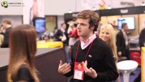 The World Needs More GIFs of Sam Biddle Dancing With CES Booth Babes