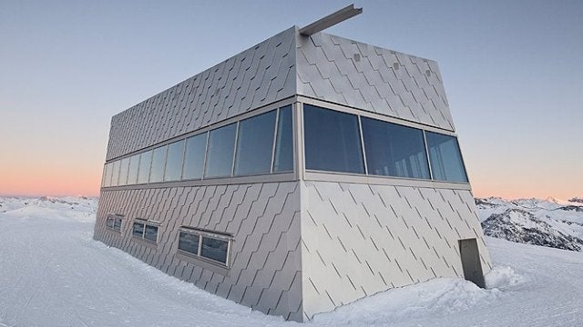 Dine Among the Peaks in This Aluminum-Scaled Alpine Eatery