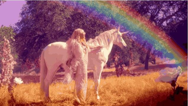 Paris Hilton Lovingly Strokes a Unicorn Under a Rainbow in New Video