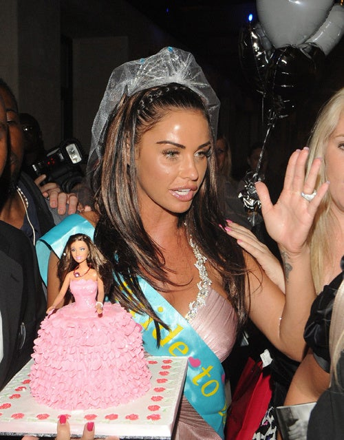 Katie Price Is Beside Herself, Literally
