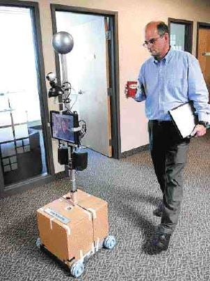 IvanAnywhere Robot Sits At Work For You