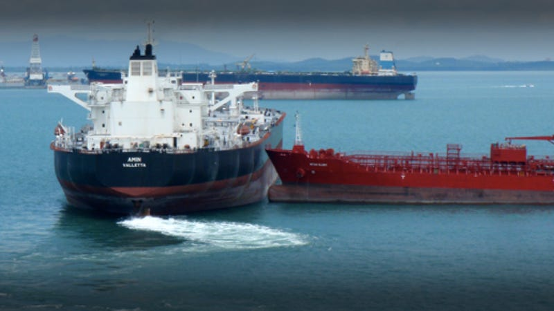 Two massive oil tankers miss each other by inches