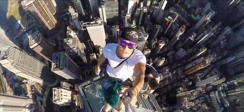 Three People Eat Bananas, Take Selfies on Top of Hong Kong Skyscraper