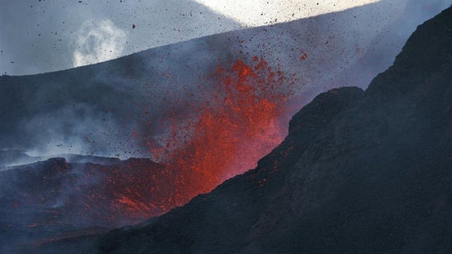 What causes supervolcanoes to erupt?