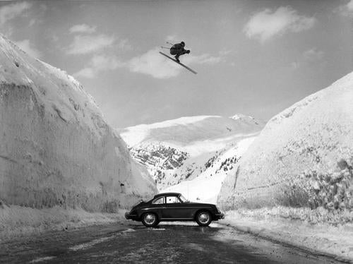 Egon Zimmermann flying over a Porsche 356