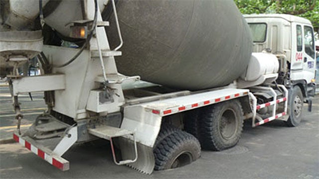 A Twelve-Ton Cement Truck Stuck In The Road