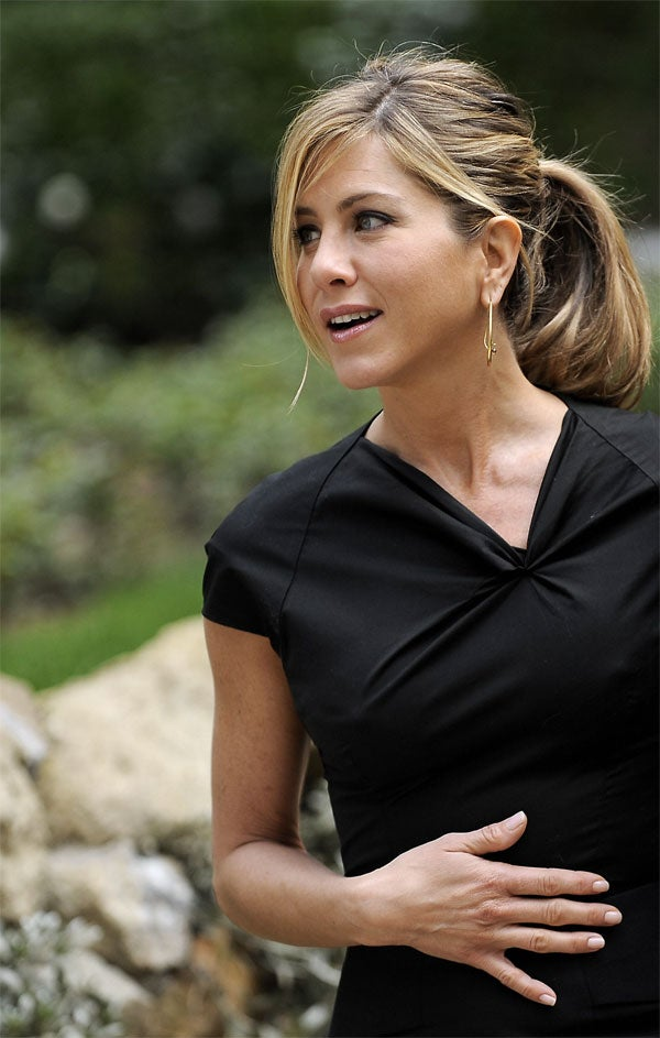 Radiant Jennifer Aniston Incites Tabloid Womb Watch