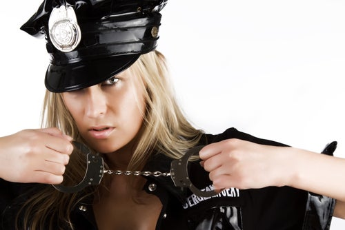 Baltimore's Sexy Policewoman Is Neither a Cop Nor a Woman
