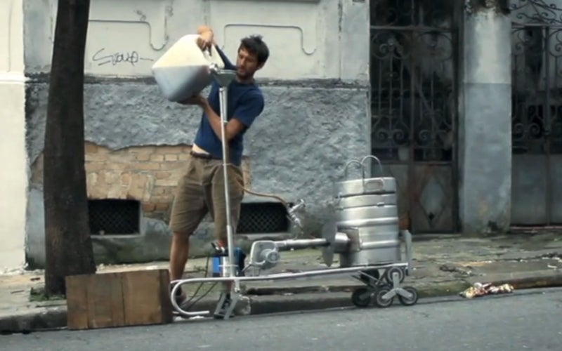 Watch a Designer Turn Soda Cans Into Stools on a São Paulo Street