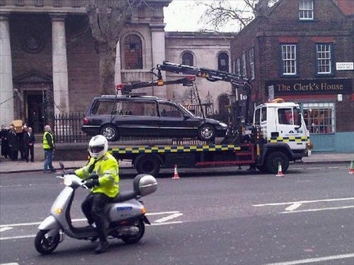 This Has To Be Fake: Hearse Towed During Funeral