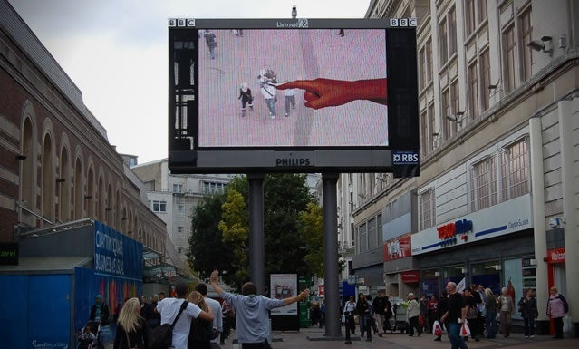 Augmented Reality Finger Billboard Prods, Destroys Passersby