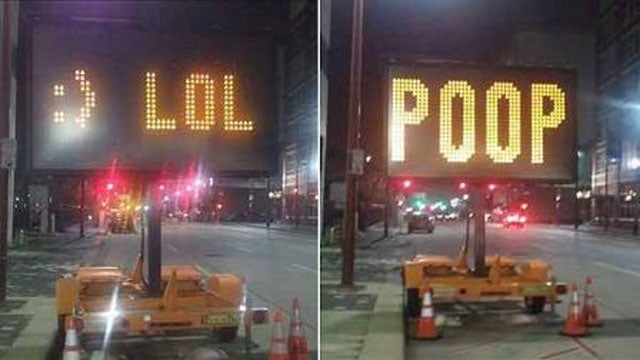 """If you hack an electronic road sign, please don't write """"POOP"""""""