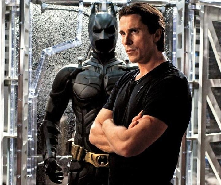 6 new Dark Knight Rises snapshots show off Batman's Bat-abs