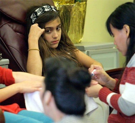Lourdes Ciccone Pampers Her Cuticles, Hides Behind Hair