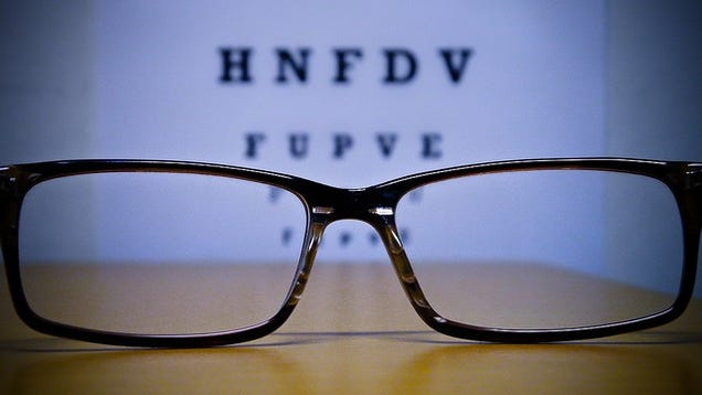 Picture of glasses against an eye exam chart