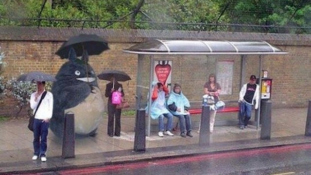 Totoro gets caught in the rain waiting for the bus