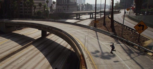 Lonely skater explores eerie Los Angeles empty of any cars