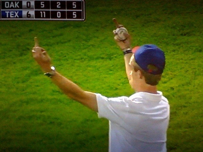 Texas Fan Celebrates His New Souvenir With A Double-Barreled Salute