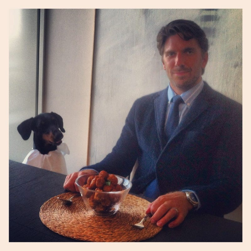 Here's Henrik Lundqvist And His Doberman Sitting Down To A Meal
