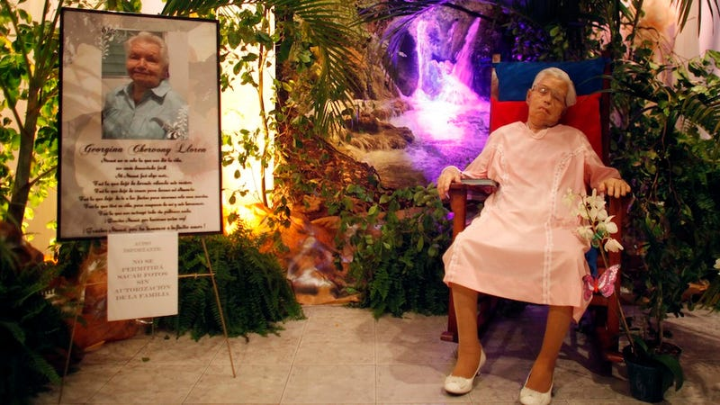 Dead Woman Posed at Wake in Rocking Chair and Wedding Dress