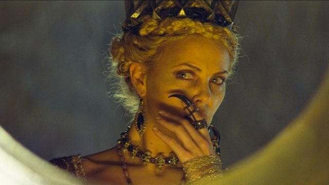 New images of Charlize Theron's soul-sucking Evil Queen ushers back the era of Black Fantasy