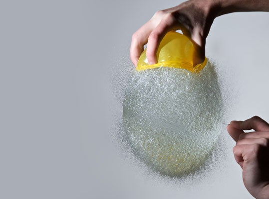 High-speed photographs capture water balloons the moment after they pop