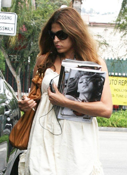 Eva Mendes Wonders Who That Sexy Girl On The Back Cover Is
