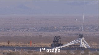 Watch a rocket sled attached to a parachute shoot through the desert!