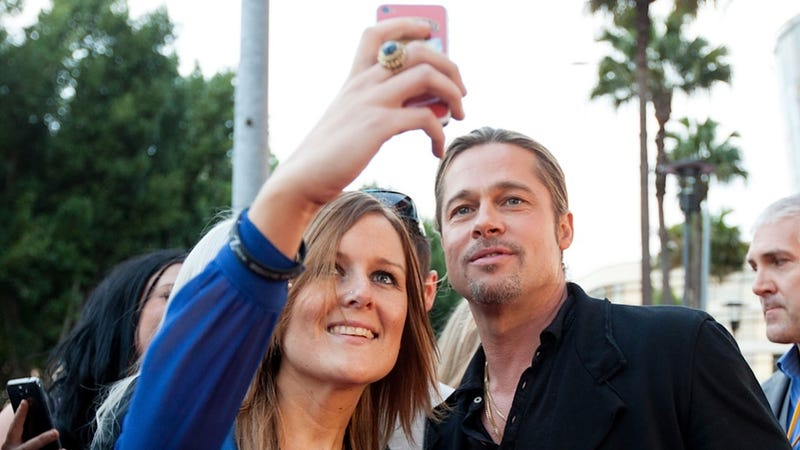 Brad Pitt Doesn't Have the Energy to Feign Excitement for Pictures